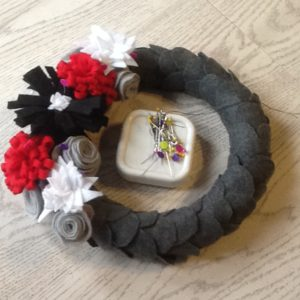 attaching flowers to felt wreath